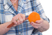 Peeling an orange — Stock Photo