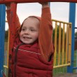 Small boy playing on the playground — Stock Photo #3070825