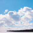 Sky with cumulus clouds over field — Stock Photo