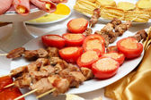 Meat canapés and tomatoes — Stock Photo