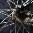 Gear on wheel of modern city bicycle — Stock Photo
