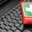 Stock Photo: First aid kit on laptop keyboard