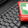 First aid kit on laptop keyboard — Stock Photo