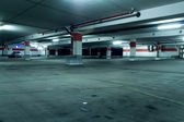 Grunge underground parking garage — Stock Photo