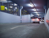 Traffic in underground parking garage — Stock Photo