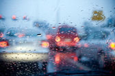 Car driving in a rain storm background — Stock Photo