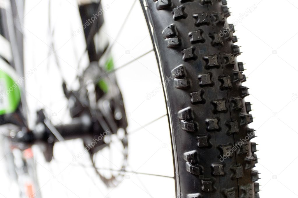 Wheel with tire of mountain bicycle isolated on white — Stock Photo #3029881