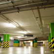 Stock Photo: Underground parking garage with car