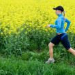 Woman running outdoors, motion blur — Stock Photo