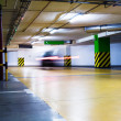 Stock Photo: Moving blurred car in parking garage