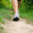 Stock Photo: WomWalking Cross Country and Trail