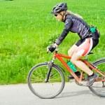 Young woman riding a mountain bike — Stock Photo #3119826