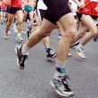 Marathon runners on the run in city - Stock Photo