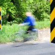 Blurred cyclist on country road — Stock Photo
