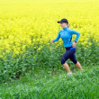 Young womrunning on trail — Stock Photo #3132052