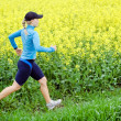 Young woman running on trail — Stock Photo #3132058