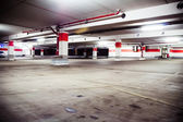 Parking garage, grunge underground interior — Stock Photo