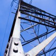 Silhouette of electricity pylon over blue stormy sky — Stock Photo
