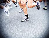 Marathon runners, running motion blur in city — Stock Photo