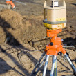 Theodolite on construction site — Stock Photo