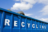 Recycling container over blue sky — Stock Photo