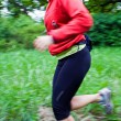 Woman running cross country — Stock Photo #3437250