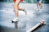 Running in marathon in hot summer — Stock Photo