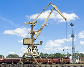 Crane at loading dock — Stock Photo
