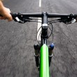 Stock Photo: Bicycle rider, motion blur
