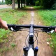 Bicycle ride in city park — Stock Photo