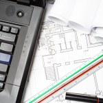 Laptop and architect blueprints — Stock Photo