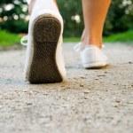 Walking woman in park — Stock Photo