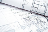 House blueprints and rolls — Stock Photo
