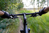 Riding mountain bike in summer — Stock Photo