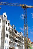 Construction site and crane — Stock Photo