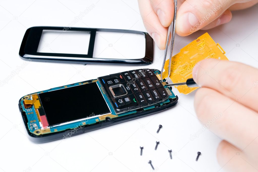 Mobile phone repair by electronic technician — Stock Photo #3738212