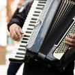 Street musician playing accordion — Stock Photo