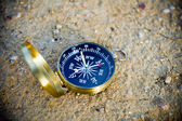 Compass on sand — Stock Photo