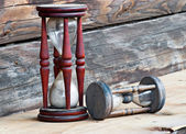 Two old dusty wooden sand clocks, on wooden background — Stock Photo
