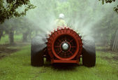 Sprayer in an apple orchard — Stock Photo