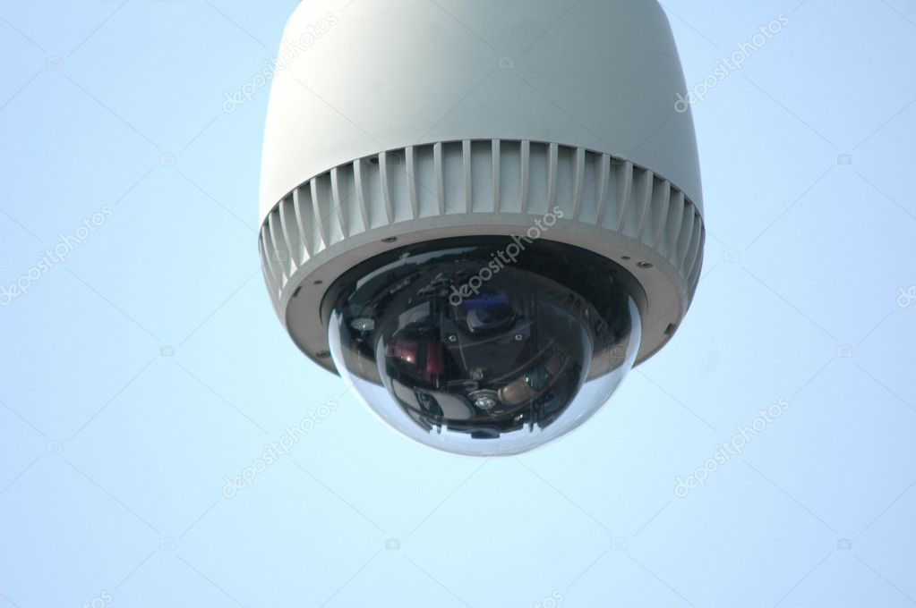 Overhead video security camera against a blue sky — Stock Photo #3266071