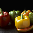 Bell and Chili peppers against black — Stock Photo #3639525