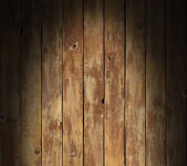 Distressed wooden surface lit dramatically — Stock Photo