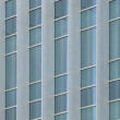 Exterior windows of a modern commercial office building — Stock Photo