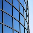 Curved exterior windows of a modern commercial office building — Stock Photo