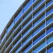 Curved exterior windows of a modern commercial office building — Stock Photo #3818209