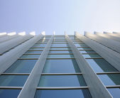 Exterior windows of modern commercial office building looking up — Stock Photo