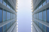 Exterior windows of two identical modern buildings — Stock Photo