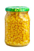 Glass jar with marinated corn grains — Stock Photo