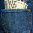 Jeans pocket with $100 bills — Stock Photo